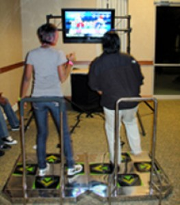 ddr with lcd montior 2 women - web3