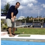 poolside golf - golfer hitting - web